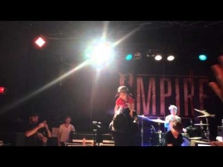 Alesana Singing With His Son On Stage