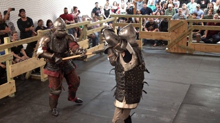 Brutal armored combat axe fight full contact steel weapons in Dallas Texas