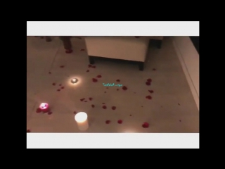 Romantic evening with rose petals in the penthouse with an overview of the city at night
