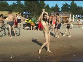 Slim_teen_with_perky_boobs_naked_at_a_nudist_beach_-480p