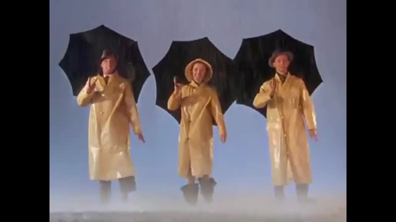 Gene Kelly, Debbie Reynolds and Donald OConnor perform the opening number in Singin In the Rain. 1952.
